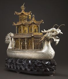 A MONUMENTAL CHINESE SILVER AND SILVER GILT DRAGON BOAT ON STAND Maker unknown, China