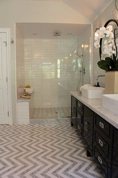 Love how the floor and the shower floor flow:  love the long tiles in the shower also:  very pretty:  could do the herringbone  pattern in the niches or a square on one wall???