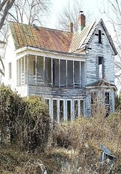Abandoned house with a second story screened porch.