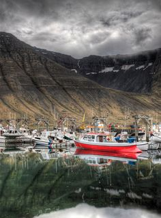 As soon as I drove into Isafjordur in the very remote area of NW Iceland, I went right to the docks. The water was so calm and perfect that it was beyond belief. I was super-tired, and I thought that the still water MUST be a unique phenomenon, so I toughened up to go take a bunch of photos. - Isafjordur, Iceland - Photo from #treyratcliff Trey Ratcliff at http://www.stuckincustoms.com/