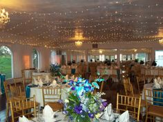 Stunning blue centerpieces add pops of color to this historic wedding venue. {Bristow Manor}