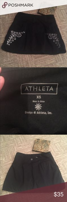 ATHLETA BLACK TENNIS GOLF SKIRT WITH POCKETS Pre loved perfect condition ATHLETA brand tennis golf skirt with built in shorts underneath! Has beautiful silver pattern on the front and two pockets in the front zipper pocket for tennis ball/ golf balls on the back! Athleta Skirts