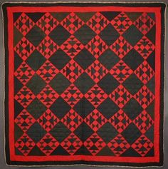 """Mennonite Double X Quilt: Circa 1900; Pennsylvania  Deeply saturated colors in a variety of wools make this Mennonite Double X pattern quilt particularly rich and dense. (Red is actually more wine or ruby colored than on the monitor). Subtle variations in the tone on tone designs within the blacks. Excellent condition. Circa 1900; western Pennsylvania origin. Measures 75"""" x 77'"""