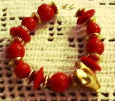 Wow them with red hot heart bracelet accenting the perfect outfit. Bracelet is handcrafted from upcycled beads.