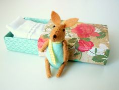 Felt bunny in match box bed.