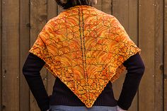 Flame Keeper Shawl - traditional top-down triangle knit from the center out in fingering weight.  Three sizes.