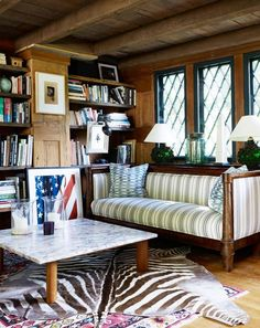 Every Bibliophile's Dream: 9 Perfectly Imperfect & Lovely Libraries | Apartment Therapy-The low beamed ceiling and leaded-glass windows give this library from My Domaine an old-fashioned, British charm.