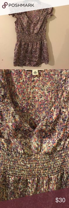 Banana Republic smocked floral blouse Banana Republic shiny floral blouse with smocking at waist and chest and cap sleeves EUC, machine wash cold  or dry clean option, 100% satin polyester deep v neck may want to wear a camisole if for business Banana Republic Tops Blouses
