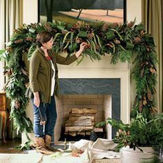 Lush Mantel Swag || Start with a faux garland. Space five pieces of water-soaked florist foam, secured inside cages, along the mantel. (Cover your mantel in plastic to protect it.) Insert magnolia, holly, pine, and cedar . Make loops from aspidistra leaves Layer in milo, millet, and rose hips