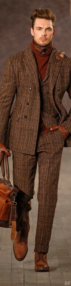 Talk about doing the most!Brown double pocket tweed with vest, cable sweater, ascot, AND feather lapel pin.