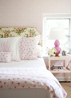 girly bedroom, floral headboard, mixed patterns, pink lamp, monograms, bedroom styling, upholstered headboard