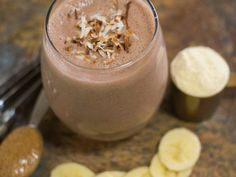 1 cup Silk Unsweetened Coconutmilk     1 scoop chocolate protein powder     1/2 frozen banana*     1 Tbsp almond butter     Toasted coconut, for garnish
