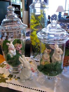 Fill jars or hurricane vases with ceramic bunnies and greenery!