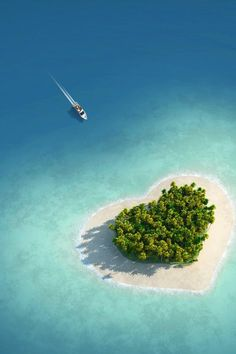 The heart shaped Tavarua island of Fiji, Oceania. I can imagine honeymooners boosting their local tourism just to visit this island. XD