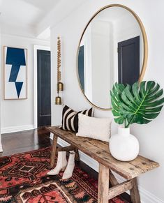 Jewel tone colors and texture were a priority when making over this one-bedroom NYC apartment—and it definitely shows in the entryway. Head to the link in our bio to get inspired by the space! Decoration Hall, Decoration Entree, Entryway Decor, Entryway Ideas, Modern Entryway, Entrance Ideas, Boho Chic Entryway, Small Entrance Halls, Home Entrance Decor