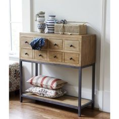 Penelope Console | Ballard Designs - bathroom with baskets at bottom for additional storage