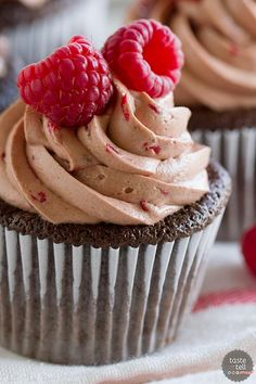 Chocolate Cupcakes with Raspberry Filling and Raspberry Chocolate Buttercream from @tasteandtell