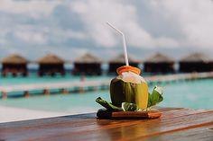 Coconut drink on luxury tropical resort by Nadya&Eugene Photography #NadyaEugenePhotography #CoconutDrink