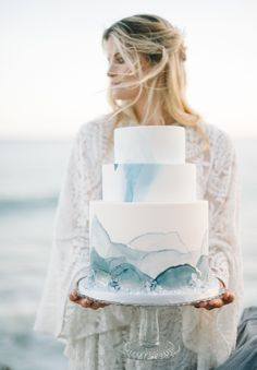 Martha Stewart Wedding has gathered 21 unique and beautiful wedding cakes for your summer beach destination wedding. With mixtures of fondant and buttercream with touches of beachy items, like oysters sea greens and beautiful blues these cakes are a perfect detail for your wedding oasis. #Wedding #Cakes #Buttercream #Fondant #Beach #Destination #Oyster #Weddings #Details #Inspiration #Summer #Fall #Winter #Spring | Martha Stewart Weddings Martha Stewart Weddings, Beach Wedding Decorations, Beach Weddings, Beach Wedding Cakes, Destination Weddings, Blue Beach Wedding, Fondant Wedding Cakes, Indian Weddings, Gold Wedding
