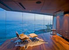 Not wild about the things in the room, but wow, that wall of glass with an endless ocean view... More