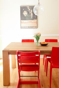 The kitchen table is the first thing I bought after we closed on our house. I love the dynamic of the rough table with the slick Bellini chairs. The Munch poster came from a flea market in Brooklyn.