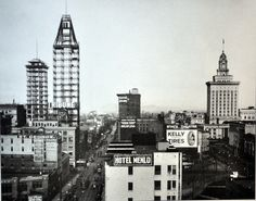 """Oakland downtown 1922. The Tribune Tower being built; city hall to the right.    """"race to the sky"""", Oakland downtown, from """"Images of America, Selections from the Oakland Tribune Archives"""", by Annalee Allen"""
