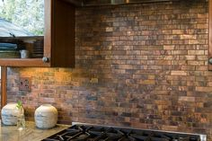 Copper tiles create a cool backsplash in the traditional kitchen - Decoist