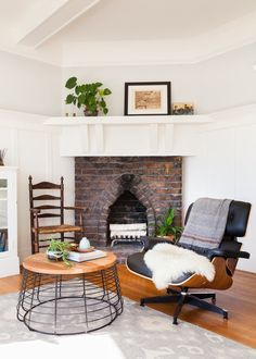 A Victorian-Era Rental in San Fran Mixes Target With Vintage Finds   Hunker Painted Lady House, White Wood Paneling, Antique Armchairs, Low Dresser, Antique Coffee Tables, Home Fireplace, Fireplaces, Gravity Home, San Francisco Houses