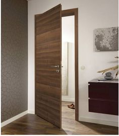 Walnut Doors look like veneer, feel like real wood, but are particularly strong and easy to maintain. Made to measure walnut doors as fire rated door sets. Door Design Interior, Main Door Design, Wooden Door Design, Interior Barn Doors, Internal Doors Modern, Internal Wooden Doors, Door Design Catalogue, Latest Door Designs, Walnut Doors