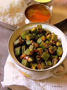 Bhindi ki sabzi is a scrumptious stir fry vegetable dish made with okra. Okra is a slimy vegetable but once nicely it is nicely friend, it tastes awesome. Some call it lady finger and we call it bh… Curry Recipes, Vegetarian Recipes, Cooking Recipes, Healthy Recipes, Cookbook Recipes, Delicious Recipes, Healthy Foods, Indian Okra Recipes, Asian Recipes