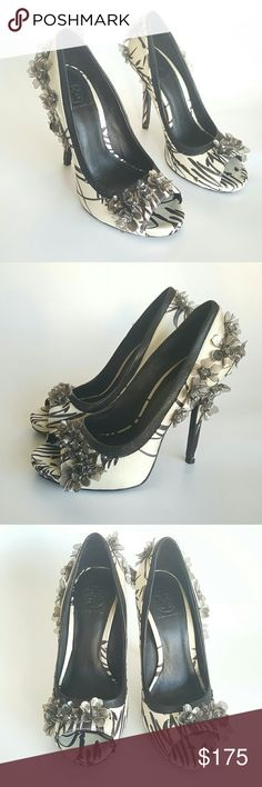 Tory Burch Pixie Satin Pumps. 100% authentic pair of shoes from Tory Burch, absolutely amazing, stylish and these are statement, perfect with black or white or cream outfit.  Of white & black calligraphic pattern, floral applique with gunmetal gems. Upper satin with trim black leather, soles are leather too,lining. Excellent condition been worn only twice.  Selling these for my friend. No box or dust bag. Tory Burch Shoes Heels