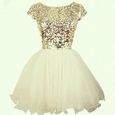 Gold sparkled top with white layered style skirt
