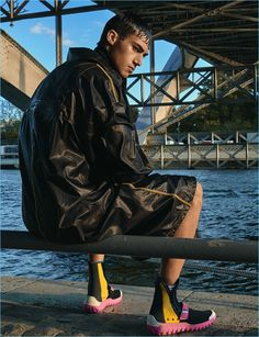 Italian model Alessio Pozzi embraces a moody moment in a spring look from Prada.