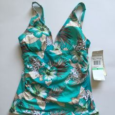 Beach House Swim Top Beautiful tankini top with adjustable straps and built in padded cups. Brand new! Beach House Swim