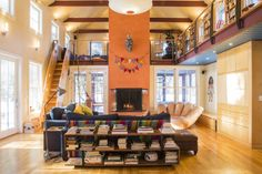 Jon and Pamela Voelkel added a large great room and screened porch to their historic home in Norwich, Vt., known as the Admiral Converse house. The loft playroom is designed with nautical touches, like the companionway-style staircase.