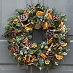 Orange lotus pod cinnamon wreath Christmas Door Wreaths, Christmas Flowers, Christmas Mood, Christmas Makes, Outdoor Christmas Decorations, Victorian Christmas, Rustic Christmas, Homemade Christmas Gifts, Christmas Crafts