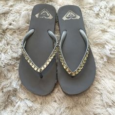 Roxy Flip Flops Roxy flip flops. Gray with crystals. Worn a few times. Still great condition!! Roxy Shoes