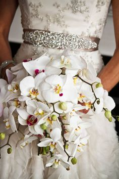 wow dress and unique bouquet - Misti Layne via CeremonyBlog.com...