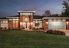 Love the windows at the roof line around the house and the garage doors.  Brings in a lot of natural light.
