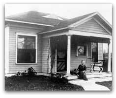 House built by Josephine Hall Clark where 'Abdu'l-Bahá gave a talk and blessed the home saying, 'God willing, it will always be a Mashriqu'l-Adhkar'. Mrs. Clark sitting on the steps with her dog 'Prince'. This home is now owned by the Spiritual Assembly of Denver.