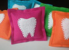Place a lost tooth in the tooth-shaped envelope on the front of the pillow. The pillow can sit on or next to the bed and the Tooth Fairy will have no trouble finding it!