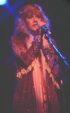 sad Stevie onstage, caught up in feelings of the song she was singing ~ love her glittery yet demure outfit ~ ☆♥❤♥☆ ~