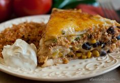 Mexican Lasagna with White Sauce - YOU WILL REALLY LOVE THIS DISH. EASY TO MAKE AND WITH RICE AND SOUR CREAM ON THE SIDE, YOU WILL BE READY TO EAT. TRY THIS DELICIOUS DISH, AND MAKE EVERYONE HAPPY.  A KEEPER FOR SURE...ENJOY
