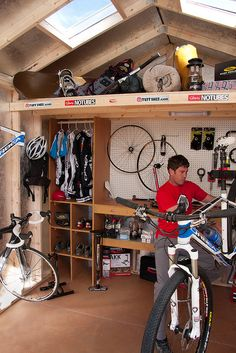 Interior of TUFF SHED PRO Sports Edition. Added features: workbench, shelving, overhead loft, skylights, cubbies, apparel closet, bike racks.