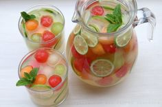 Serve the melon sangria garnished with lime slices and mint leaves