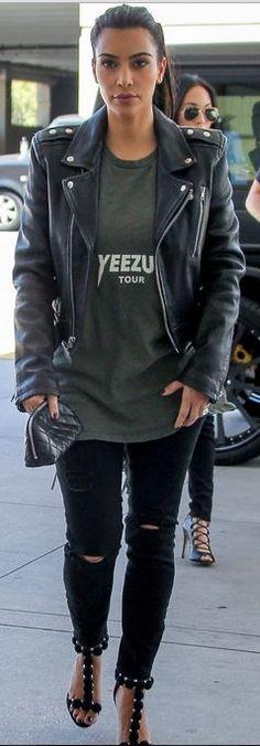 Who made  Kim Kardashian�s black leather jacket, green print tee, sandals, and woven clutch handbag