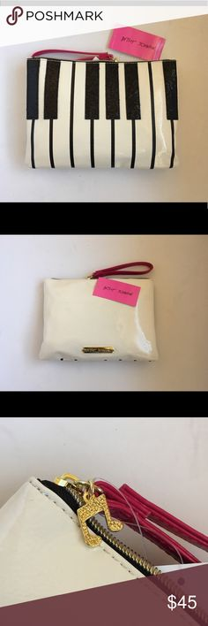 """Betsey Johnson Piano Keyboard Purse/clutch  Betsey Johnson Patent Leather Purse/Clutch. Black glitter keys, with white PU patent leather white keys. There is a cute musical note zipper. Inside zipper bags with several small pockets. Measurement: 10.4""""(L"""