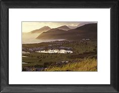 22x18 (56x46cm) Framed Print featuring Caribbean, St. Kitts. North Frigate Bay golf course and hotels at sunrise. Wood grain effect frame with professionally mounted print. Overall outside dimensions are 22x18 inch (566x465mm). Features hardboard back stapled in with hanger and glazed with durable Styrene Plastic to provide a virtually unbreakable glass-like finish. Easily cleaned with a damp cloth.