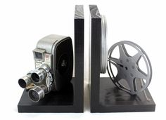 Original Keystone K26 or K27 Capri Triple Turret 8mm Camera, 8mm film and film reel – modified into a pair of bookends. Unique cameras with some signs of years of service. This is an original vintage movie camera and not a replica. The bookends are also a great gift and add a little vintage flair to any room. These are nice gifts for the movie fan or the vintage lover. They are also perfect to display your DVD collection and decorate your home theater or any room with a little vintage movie…