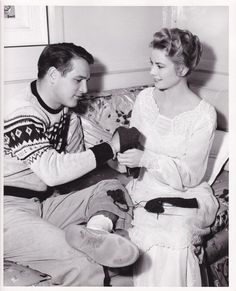 """anothergracekellyblog: """" MGM's newest star, Paul Newman, assists Grace Kelly with her knitting on the set of The Swan, 1955 """"HOLLYWOOD'S NEW STAR… is a new man, Paul Newman. In two pictures at MGM, as a war hero accused of collaboration in The Rack..."""